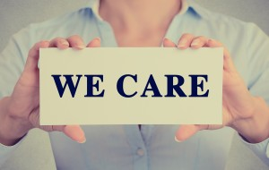 WE CARE sign
